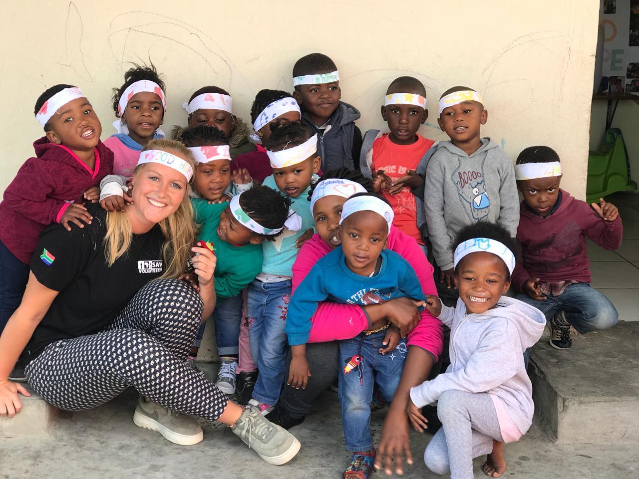 Volunteers and children