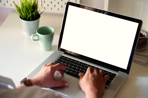 side-view-man-working-with-laptop-is-work-table-conner-office_67155-1474