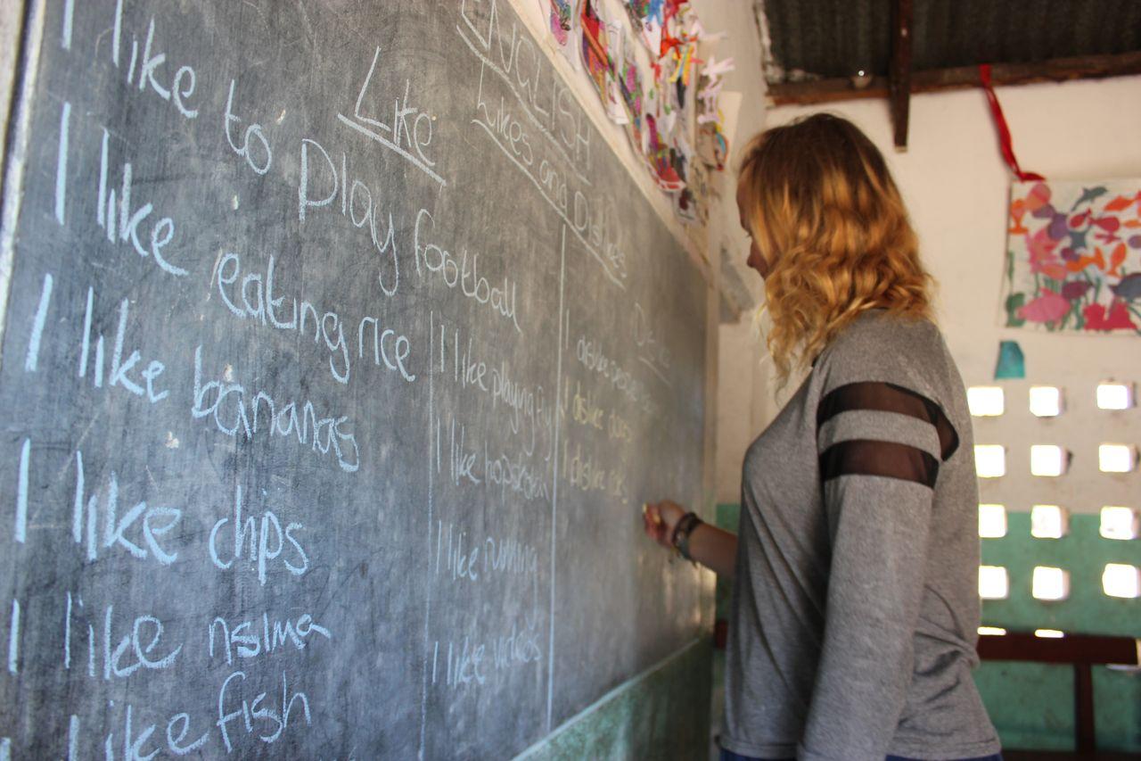 Teacher and chalk board